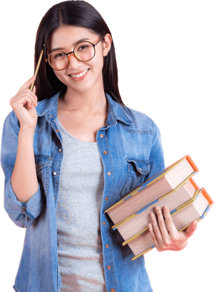 Student with glasses standing and holding a book
